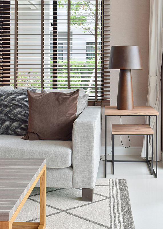 wooden table lamp on wooden table next to sofa set in living room