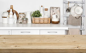 Brown wooden texture table over blurred image of kitchen bench
